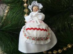 Peru clothespin doll ORNAMENT, white dress - red and pink apron - ready to ship Dress Red, White Dress, Pink Apron, Clothespin Dolls, Wooden Pegs, Red And Pink, Peru, Ship, Christmas Ornaments