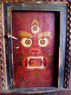Doors as art. Doors in Lhasa, Tibet. Drawing on the door looks like a talisman against evil spirits Cool Doors, Unique Doors, Lhasa, Art Du Monde, When One Door Closes, Tibetan Art, Tibetan Buddhism, Knobs And Knockers, Door Gate
