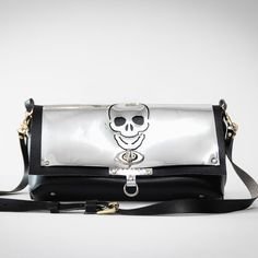 Crossbody lightweight faux leather bag with laser cut skull design.. Interior lipstick holder + pocket Fits all phone sizes Exterior credit card slots Adjustable Belt Buckle crossbody strap Turn Key Clasp closure metallic skull detailing. Material: synthetic/artificial leather outer layers. Leather Purses, Leather Bag, Lipstick Holder, Skull Design, Artificial Leather, Belt Buckles, Vegan Leather, Layers, Metallic