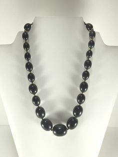 Presenting a jet black graduated bead necklace with silver tone spacer beads. Boho chic hipster necklace, mid century mod MCM, casual jewelry,