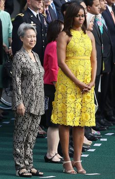 Michelle brought the sunshine by wearing a yellow floral embroidered Naeem Khan halter dress. Beautiful color! Perfect spring time color!