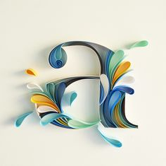 Alphabet designed with paper strips inspired by splashes of water. This hand crafted letter is 4 inches in height on a square base of 8 inches. Onl...
