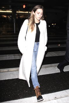Olsens Anonymous Blog Elizabeth Olsen Style Airport Look Long White Textured Coat Tucked Black Shirt Light Denim Boyfriend Jeans Sorel Winter Rain Boots