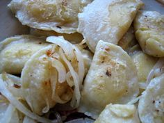 Homemade Pierogi  Ingredients:  2 cups flour, plus extra for kneading and rolling dough  ½ teaspoon salt  1 large egg  ½ cup sour cream  ¼ cup butter, softened and cut into small pieces  Butter and onions for sauteing  Ingredients for filling of your choice (Potato & Cheese filling recipe below)