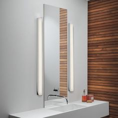The Artemis 900 LED Bath Bar f= light gives off a soft illumination around the bathroom mirror. The flexibility of being able to mount it above or on either side of a mirror allows this light to fit in with a range of bathrooms. Led Bathroom Lights, Modern Bathroom Light Fixtures, Bathroom Vanity Designs, Best Bathroom Vanities, Bathroom Ideas, Bathroom Updates, Bathroom Inspiration, Vanity Lighting, Strip Lighting