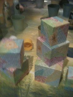 Baby Madelyn shower 2014 these blocks I made from marked down gift boxes you can also find them at the dollar tree two sizes for a dollar. Used clear craft glue an cut up fabric left over from country shower they turned out great at a cost about 40 cent they made great center pieces.
