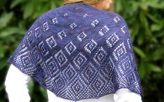 Shattered Stars is a stunning semi-circular shawl, worked top down with a diamond motif.