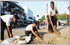 #Pune defence staff of the sation workshop carry out a road cleaning drive under the 'rashtriya swachta abhiyan' on MG road in pune camp on tuesday. more than a hundred staff members participate is the drive. Source : TOI