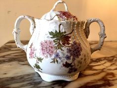 """Lovely Limoges France porcelain Tea/coffee set of Tea Pot, Sugar bowl and Creamer. Beautiful flower design, hand painting pink, perple flowers with green leaves. Sugar bowl - 6 1/4"""" high; 7 1/4"""" - wide; 5"""" - diameter. 