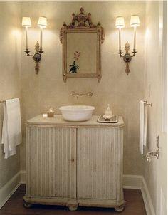 John Saladino gorgeous bathroom, vanity cabinet, vessel sink, sconces