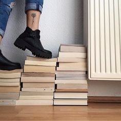 One of my favourite pictures I took #bookstagram#book#books#reading#reader#bookphotography#bookstagramfeature#stackofbooks#boots#combatboots#bookish#reader#bookworm#tattoolove#travelgram#fingertattoo#smalltattoos#tattoo#tattoos#tattooed#tattooedlife#tattooedgirls#ankletattoo#rosetattoo#lotustattoo#freedomtattoo#tatted#tattedgirls#ink#inked#inkedgirls