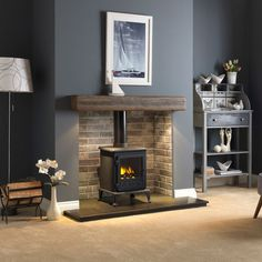 Renovate Your Old Fireplace With These Fireplace Makeover Ideas : A fireplace is something that makes the house look industrial and elegant and looks good. Revamp your old fireplace by these top Fireplace Makeover Ideas. Home Living Room, House, Home, Home Fireplace, Fireplace Design, New Homes, Log Burner Living Room, Fireplace, Cosy Living Room
