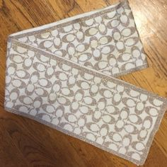 Authentic Signature Coach Scarf AUTHENTIC & IN PERFECT CONDITION! super cute and warm scarf. It's cream and tan in color with shimmer thread. One side is tan with shimmer and cream C's. The other side is cream with tan shimmer C's. Coach Accessories Scarves & Wraps