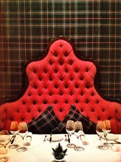 Tufted red banquette, tartan, photo by Ray Main