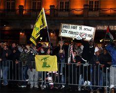AK on Hezbollah flag
