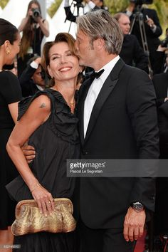 Jury member Mads Mikkelsen (R) and Hanne Jacobsen attend 'The Unknown Girl (La Fille Inconnue)' Premiere during the 69th annual Cannes Film Festival at the Palais des Festivals on May 18, 2016 in Cannes, France.