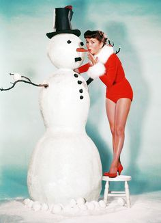 Debbie Reynolds - Christmas 1950's - Am I the only one who's a little disturbed by the way she's kissing his nose? ;)