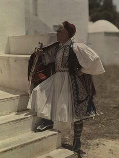 Man dons uniform of the Royal Guard, first introduced by monarch Otto. Greece. National Geographic's Greece in Color from the 1920s Photographer: Maynard Owen Williams in the 1920s
