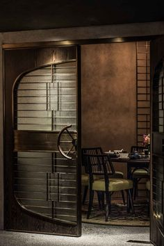 A contemporary Cantonese restaurant in the basement of the Standard Chartered Bank building in Central. The original structure of the site lent itself to a layout that consists of different dining experiences of varying character and intimacy. The restaur Restaurant Door, Luxury Restaurant, Restaurant Concept, Restaurant Lighting, Restaurant Design, Restaurant Interiors, Restaurant Ideas, Top Interior Designers, Commercial Interior Design