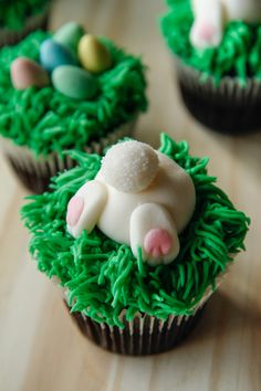 BUNNY BUTTS - These popular Easter cupcakes are easy to make and overloaded with cuteness. Chocolate cupcakes base (to look like dirt), grass-like buttercream (Wilton tip 233), and marshmallow fondant bunny butts with a sugared tail.