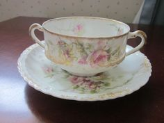 """Haviland Limoges bouillon cup and saucer by Theodore Haviland, Limoges, France. Fancy gold trim and pretty blank. Cup measures 3.5"""" by 2"""", saucer 5.5"""". No chips or cracks. 