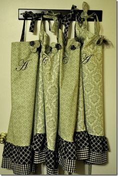 aprons- I love matchy-matchy stuff! I can see one for me and my four girls...