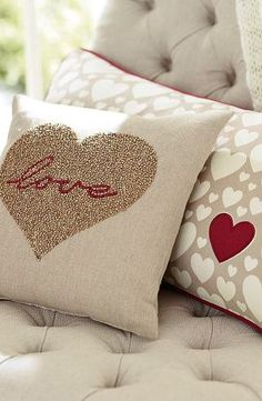 Love Heart Cushion - could easily be replicated using hand-cut heart stencil with coloured text for beginners screenprint workshop.  The back cushion could be lots of small hearts hand-cut stencil, with one single heart in different colour.