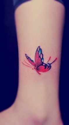 red butterfly tattoo on the leg for girl