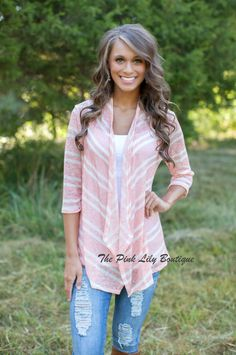 The Pink Lily Boutique - Earn Your Stripes Peach Cardigan , $32.00 (http://thepinklilyboutique.com/earn-your-stripes-peach-cardigan/)
