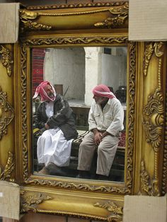 Reflection in a mirror at an antique shop in the Old Souq - Doha, Qatar.  Photo: Yantie Tingan.