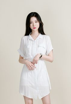 Keep it simple but stay classy with this shirt dress. It comes with a pointed collar, a button-down closure, cuffed short sleeves, a mid-thigh length to show off your flawless legs, and a self-tie drawstring belt on the waist for a flattering silhouette.