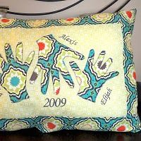 Grandparent's gift - Pillow with kids' names on it and their hands traced onto fabric and sewn on the pillow.