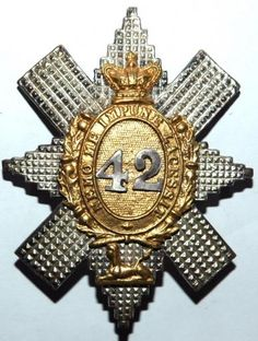 42ND HIGHLANDERS - BLACK WATCH VICTORIAN OFFICERS CAP BADGE. Pre-1881. Very nice 3-piece officers example in unmarked silver. Good, clear detail with lovely age toning. Still retaining almost all it's gilding finish.Victorian crown. Silver lugs.