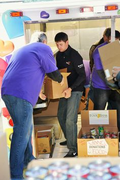 FedEx NASCAR driver Denny Hamlin, his pit crew and over 50 FedEx volunteers created disaster kits at the Community FoodBank of New Jersey on Wednesday, Nov. 14. Denny also delivered a twenty-thousand dollar donation to the food bank and over 1200 MREs (meals ready-to-eat) on behalf of FedEx for area residents affected by Superstorm Sandy.