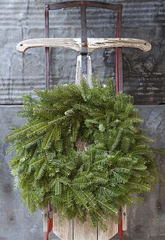 hang a wreath on a sleigh..simple