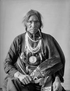 Tabaiwatang or De-Bwawen-Dunk (Sound of Eating), Called John, Chippewa, in Partial Native Dress with Peace Medal and Ornaments and Holding Fan - Gill - FEB 1901