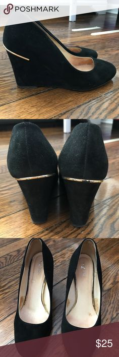 Black Suede Wedge Pumps size 7 Beautiful Suede Pumps  European Brand  Leather inside has some wear ,see spots on the picture Suede outside in great shape  Some peeling on the gold trim Beautiful shoes with a lot of life Size 7 Livier Shoes Heels