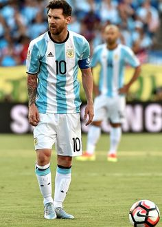 Lionel Messi playing for Argentina getting ready to take a place kick.