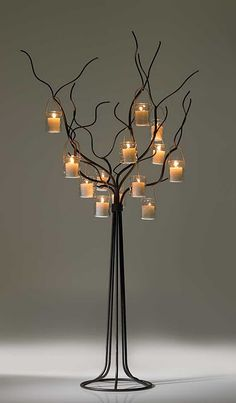 candle light tree.. great as a wedding centerpiece with our #tealights at www.wholesalecandlewarehouse.com