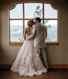 sweet romantic moment bride and groom looking out window on wedding day at Arbor crest winery by Matt Shumate Photography