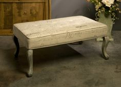 Princella Script Fabric Ottoman Table - Sophisticated European charm meets functional design in the exclusive Princella oversized ottoman table imprinted with script typography and featuring an antiqued grey wood stain on the legs. IMAX Exclusive!