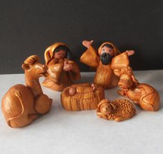 This one's clay, but looks like wood. It's different because of how happy everyone looks.