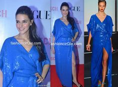 In DvF : Neha Dhupia : Lame or Fame?   The actress wore a bright blue sequined DvF gown from the  Fall 2011 collection.    While I think Neha looks goods, can't say the same about her outfit. Don't think it's flattering on her body. She's usually so well dressed, but her recent appearances have not been upto the mark.Pulled back hair and black peep toes completed her look.