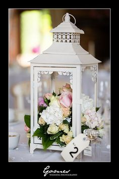A lovely creative way to decorate the table - beautiful - could also put a tag on the ring at the top for the table number... (Party Top Receptions)