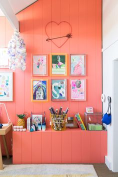 Pop of vibrant peach color from The Design Files.