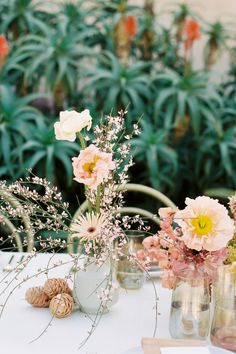 """From the editorial """"Modern-Boho Wedding Inspiration That Was Tailor Made for the Free Spirited Bride."""" The incredible team who brought this editorial to life wanted to use florals as the main statement piece- brining in tons of color, texture and an overall boho-playfulness. Head to stylemepretty.com for the full gallery!  Photographer: @elliekoleen Floral Design: @oftheflowers  #weddingflowers #weddingflorals #weddingfloralarrangements #weddingtable #bohowedding Wedding Flower Inspiration, Diy Wedding Flowers, Wedding Flower Arrangements, Flower Centerpieces, Wedding Bouquets, Wedding Stuff, Wedding Ideas, Boho Garden Party, Garden Party Wedding"""