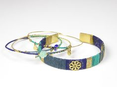 Beautiful fashionable bangle bracelets gold plated with silk and charms. www.sophisticatedgold.nl