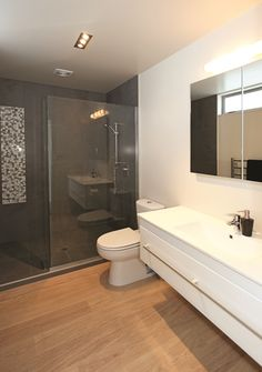 The ensuite bathroom adds a touch of luxury to the master suite. Property Design, Country Kitchen, Home Builders, Building Design, Master Suite, Home Goods, House Plans, Bathrooms, New Homes