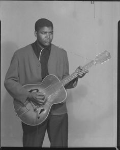"""""""Studio Portrait of Man Standing Playing Guitar"""" Collection of the Smithsonian National Museum of African American History and Culture"""