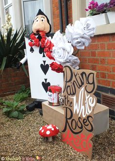 Our scarecrow Playing Card Gardener from Alice in Wonderland, painting the red roses white!